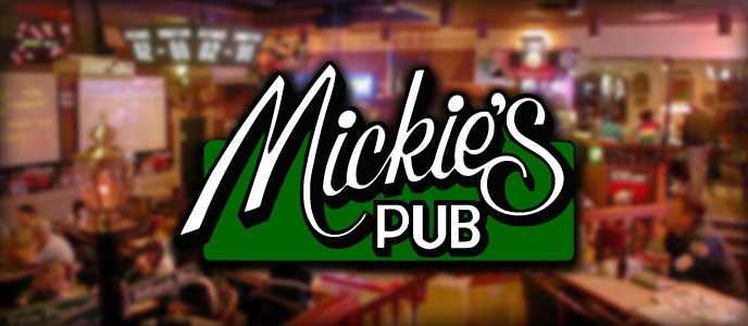 Mickies Pub Logo and back drop in the Ramada Kelowna