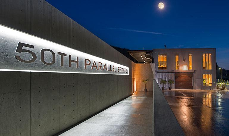 Front of 50th parallel winery at night