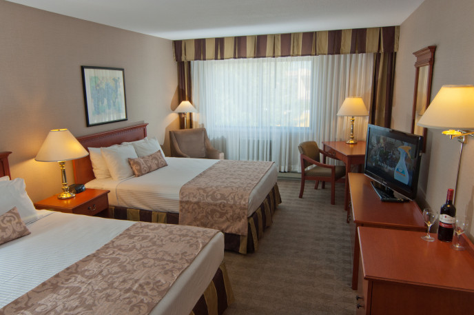 Standard Kelowna Hotel Room with 2 beds at the Ramada Lodge Accommodations