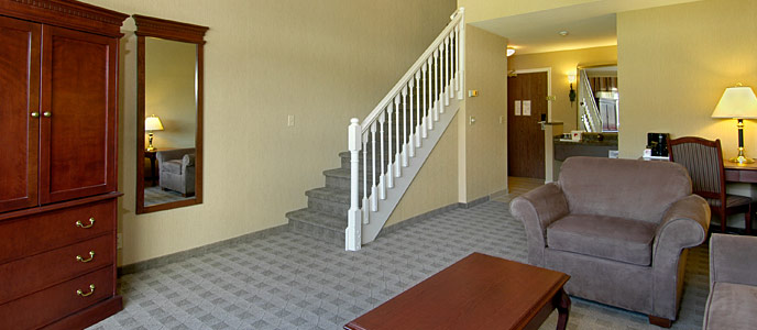 Two level loft suite living room and staircase