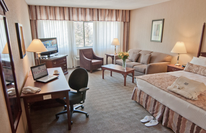 King Size Bed Business Suite With Desk at Ramada Lodge Kelowna